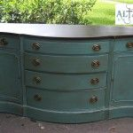 very similar to my grandmother's credenza that is in desperate need of a remake...