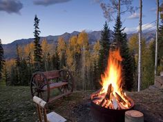 awesome contained firepit and check out that cool wagon wheel bench