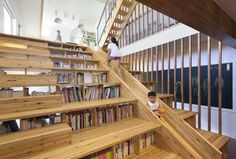 Bookshelf Staircase with Slide: Panorama House by Moon Hoon Photo