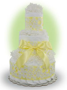 Our Yellow Lace cake consists three layers of premium Pampers brand diapers bundled together with easily removable ribbon so that every diaper is useable.  Makes a darling and elegant new baby gift. Only $49.00