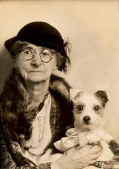 Vintage photobooth photo of old lady with her beloved little pooch