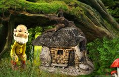A tiny gnome visits our mini troll fairy house in the fairy garden.