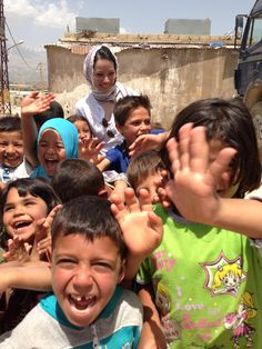 UNICEF Ambassador Lucy Liu in Lebanon having a playful morning with children displaced from #Syria. Some 150 refugee families live at a cement factory site in eastern #Lebanon, no clean water or latrines.  Courtesy of U.S. Fund for UNICEF © Azar 2013
