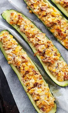 Cheesy Bacon and Corn Stuffed Zucchini - Zucchini halves stuffed with an insanely delicious mixture of cheese, bacon and corn!