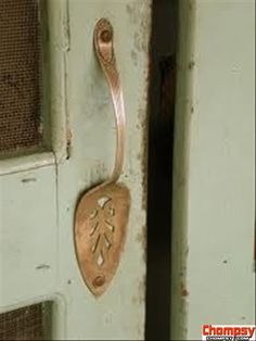 Serving spoon door handle.... Awesome idea for doing something with your odd and ends silverware collection.