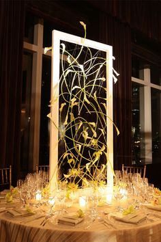 Turn your centerpiece into a work of art by crafting a frame and painting the picture with mini calla lilies