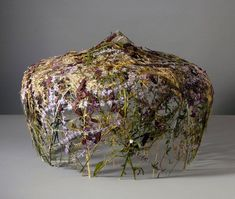 Ignacio Canales Aracil creates gravity-defying sculpture made of pressed and dried flowers.