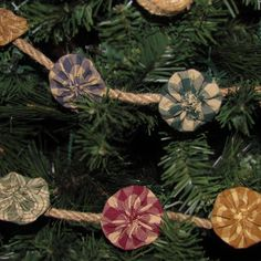 Yoyo and Jute rope Christmas tree garland.  (Maybe something smaller  in diameter then rope.  But cute and rustic.)