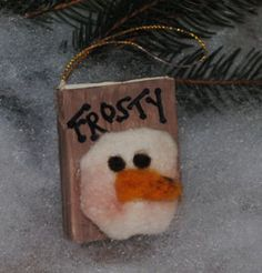 If you love Frosty the Snowman and you love books, you have found your perfect Christmas ornament craft. This Frosty the Snowbook Ornament is so adorable and so easy to make. The snowman craft has a handmade feel, using a sewn snowman head and a paper mache book as the base. This craft is quick and easy as well. You can make these for your tree and for the trees of your loved ones this holiday season.