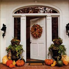 Stage the front of your home for the seasons.  Keep it traditional and appealing to increase curb appeal!