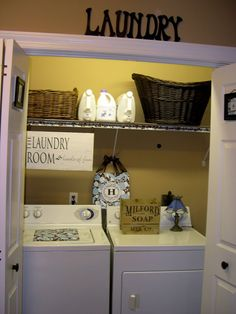Closet Laundry Room; My laundry room in my old house had the same layout, wish I wouldve done something like this to make it less of an eye sore!
