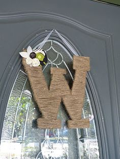 Letter cut out of pizza box and wrapped in twine, then embellished -- affordable craft!!!