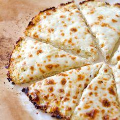 Cauliflower Pizza Crust Recipe -- Uses just 1/2 cup parmesan or mozzarella