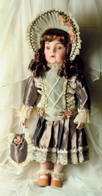 """Remember Sue - Antique Replica Dolls    Sweet faced porcelain bisque dolls are hand cast from molds of century-old German antiques. Glass eyes and intricately detailed accessory. 18"""". Gift boxed.  Outfit includes: Dress, Bloomers, & Hat."""