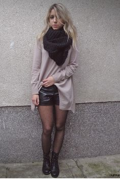 bulky scarf, baggy long sleeve dress tucked into pleather shorts, pin dot pantyhose, and black boots