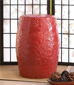 """Sunset Ceramic Decorative Stool FREE SHIPPING Now Only $83.89 The fiery red floral relief of this decorative stool injects a pop of intense color to any room.  Use it as a seat, end table, or as decoration for your home, either alone or as a display stand.  It's even versatile enough to use in your garden or on your patio!  Maximum weight limit is 220 lbs.  13 3/8"""" x 13 3/8"""" x 18"""" high.  Ceramic."""