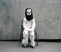 Cute but morbid child portrait: The Zombie from the series Halloween by Laura Pannack.