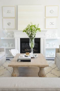 #fireplace, #mantel, #living-room, #artwork, #coffee-table, #rug, #neutral, #white  Photography: Tracey Ayton - traceyaytonphotography.com  Read More: http://www.stylemepretty.com/living/2014/03/24/the-doctors-closet-home-tour/