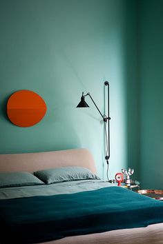 Too dark, not enough lighting in the room to support that wall color.  However, the sun wall decor is a good idea for the sky colored wall over the bed.