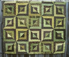 Click through this one to go to Etsy.  Be sure you like the close-up photos (photos 3 and 5).  When you are close up you lose the optical illusion, which is fine, just be sure you like that.  :) atthebrightspot, bevel block, green quilt patterns, brown handmad, green brown, block quilt, brown quilt, quiltsi team, quilt green
