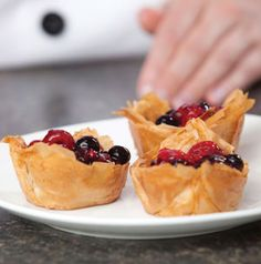 Make teeny tiny individual Blueberry Tarts for dessert. The crust is crispy phyllo sheets baked with sweet cinnamon and sugar. blueberri tart, brunch