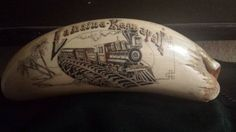 Scrimshaw of the train Lahaina Kaanapali. At least 35 years old by artist with the initials LS.  Anyone know the artist or its origins?