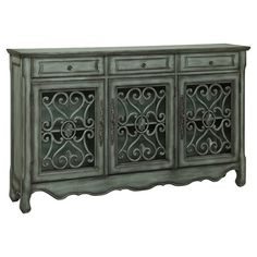 Display an array of candles or an ornate vase adorned with fresh-picked blooms atop this eye-catching credenza, showcasing 3 doors and 3 drawers for ample st...
