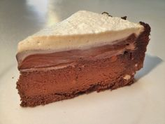 A chocolate biscuit  base with chocolate pudding cake, chocolate mousse and whipped cream. A paleo take on a Martha Stewart  classic.