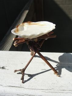 birdbath made out of twigs, wire and a seashell - cute! Maybe a butterfly on the edge instead of bird? Or a TINY bird