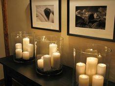 Big lighting bang-for-the-buck Dollar-Store pillar candles and hurricane glasses.