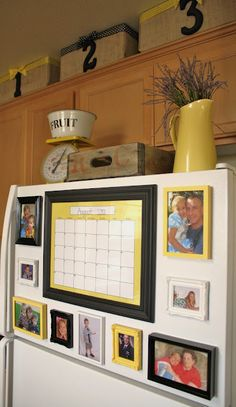 Looks much better than pictures hanging w/ magnets - use dollar store frames, paint them and put magnets on the back. Cute!