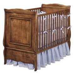 Love the simple blue crib skirt.