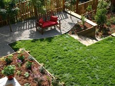 12 Budget-Friendly Backyards: A sloping, weedy backyard became three levels of very usable space in this beautiful makeover. (Design by John Black)  From DIYnetwork.com