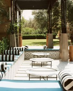 Moroccan Patio Photo - A poolside outdoor lounge area with striped pillows