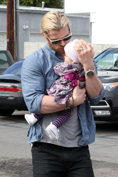 Chris Hemsworth cradles his daughter India Rose - There is something about a hot guy showing good fatherly qualities that is very attractive!!