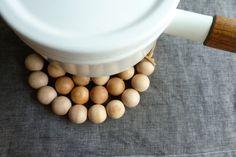 A Merry Mishap's wooden bead trivets (seen on April and May aprilandmaystudio.blogspot.com/2011/07/diy-wooden-bead-trivets.html)