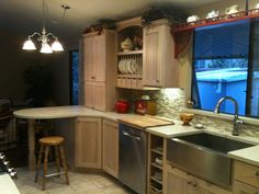 Dewils cherry cabinets with a frost finish; LG Himacs counter top.