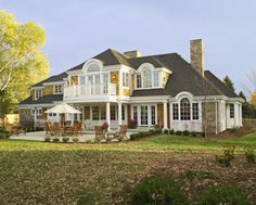 shingle style home with rock accents