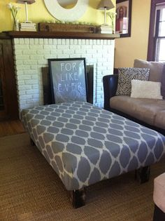 DIY ottoman from coffee table. BUT check out the framed art behind it I need that!!