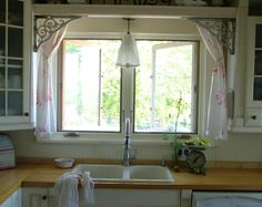 cabbage and roses fabric un-hemmed and frayed, un-ironed  farmhouse kitchen with fabric lampshade