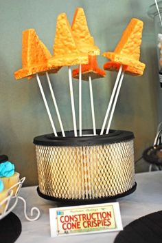 "Clever!  ""Construction Cone Crispies"": Rice Krispie Treats, coated in orange candy melts, displayed in an air filter for Construction Party"