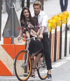 City of love: Simon Baker and a brunette model shoot the latest Givenchy campaign in Paris