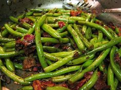 Smothered Green Beans with Bacon     6 thick slices bacon, chopped     1/2 cup onions, minced     1 teaspoon minced garlic     1 pound fresh green beans, trimmed     1 cup water     1/8 teaspoon salt     1 pinch ground black pepper