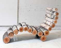Make your own Log Lawn Chair! This would look pretty cool in any yard or patio. If you're worried about comfort, I'm sure you can find a cushion to put on it! #DIY #wood #yard #decor