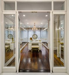 Extra glam dressing room: mirrored doors, slotted baseboard detail, storage galore - Curbed NY