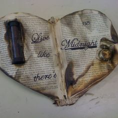 Altered book(: find an old book. Cut the pages little at a time in a heart shape then cut the cover. Find what you want to put in the pages and carve out a spot paint a saying on it THEN place the book over a lit candle to get the old burned look(: