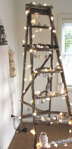 Wind twinkle lights around a vintage old wooden ladder and decorative shells, starfish for rustic cottage style home decor; Upcycle, recycle, salvage, diy, repurpose! For ideas and goods shop at Estate ReSale & ReDesign, Bonita Springs, FL