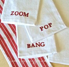 Word towels made with iron-on letters. These would be cute with  holiday words because of the red. These would also make great hostess or ho...