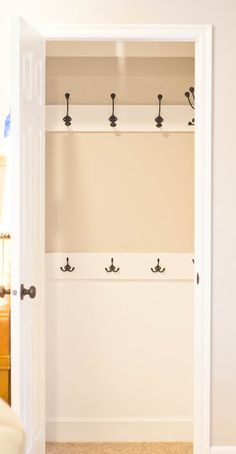Replace the rod in your coat closet with hooks to make it quicker and easier to hang up jackets.