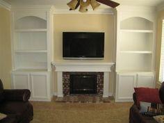 Bookshelf around fireplace